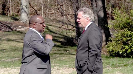 Dr. Alvin Edwards and Governor McAuliffe talking outside the meeting