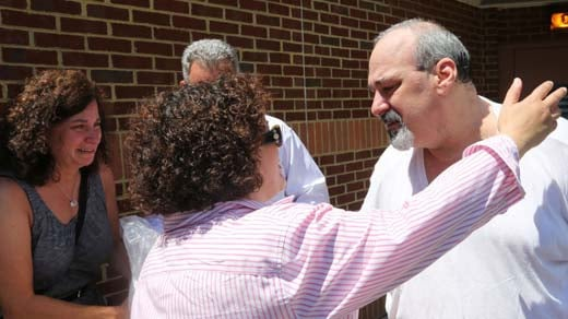 Mark L. Weiner, right, receives a hug from his sister Marcia Cohen as his wife Florence and brother Mike look on Tuesday outside Albemarle-Charlottesville Regional Jail. Weiner's guilty verdict on a 2013 abduction case was vacated, and he will be released
