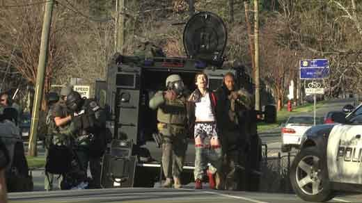 Silva being arrested by police following a standoff.