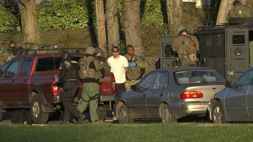Police taking Cole Nordick into custody after a standoff along 6th Street SE (FILE IMAGE)