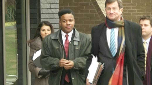 Martese Johnson with attorney Ben Chew outside federal court in Roanoke