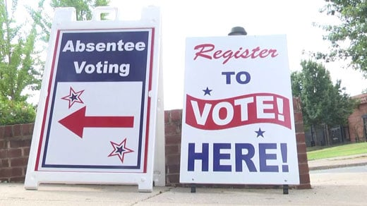 Signs outside of the Charlottesville Office of Voter Registration and Elections (FILE IMAGE)