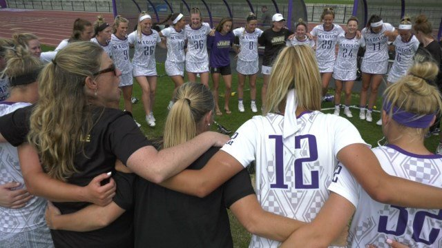 JMU head coach Shelley Klaes-Bawcombe and her team following a win in the 2018 playoffs