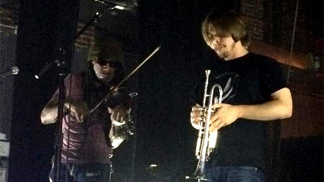 Boyd Tinsley and James Frost-Winn on stage