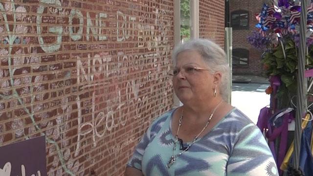 Susan Bro next to a memorial for her daughter, Heather Heyer