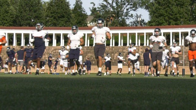 The UVa football team practiced at Lambeth Field on Thursday night