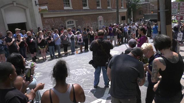 People gathered to mourn Heyer on the one-year anniversary of her death