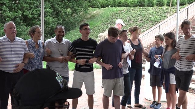Members of the prayer walk linked arms in front of UVA's Rotunda.