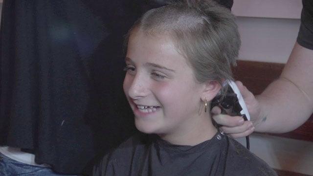Annie getting her hair cut