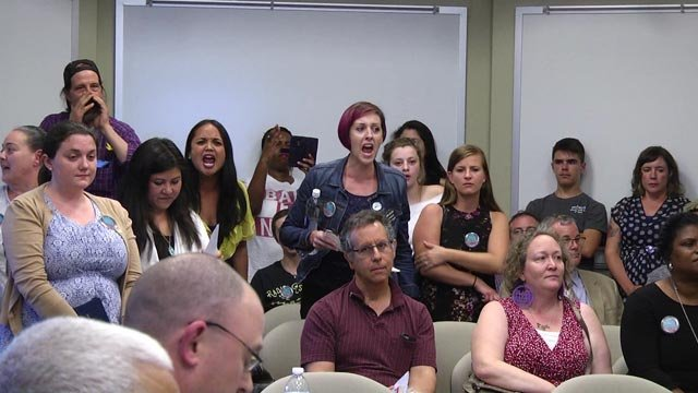 "People in the crowd yelled ""shame"" at the school board"
