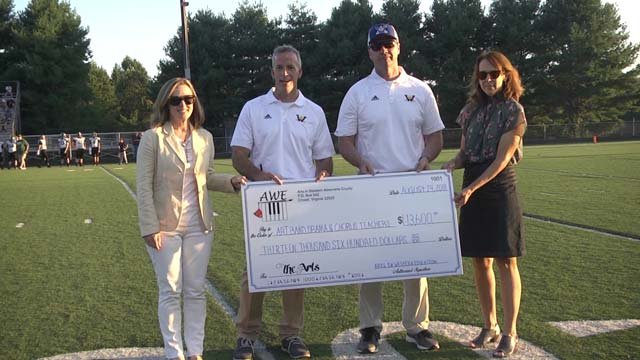 The check was presented during the football game