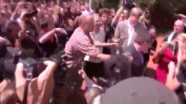 Jeffrey Matthew Winder (center, in red & white striped shirt) assaulting Jason Kessler (FILE IMAGE)