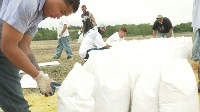 The sandbags are to help prevent flood damage to homes.