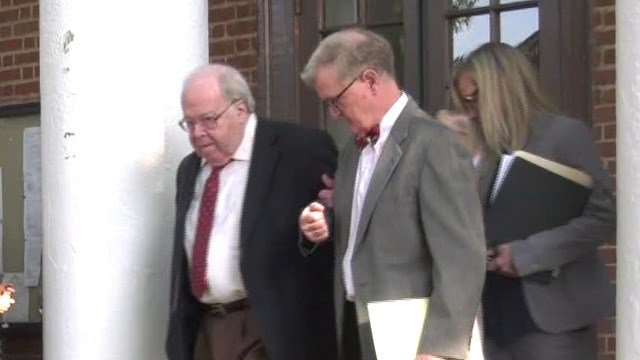 Walter F. Korte Jr. (far left) leaving Albemarle Circuit Court