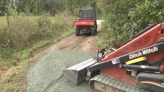 Crews laid down new gravel on the trail system.