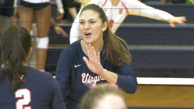 Junior Jelena Novakovic celebrates a point for the 'Hoos