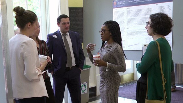 UVA students presenting research on topics relating to race and education.