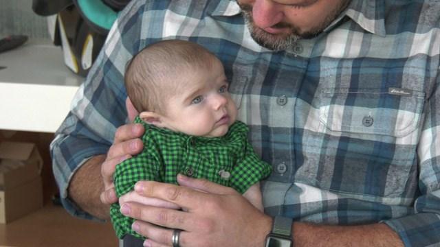 Chuck Slate holding his son, Bryson