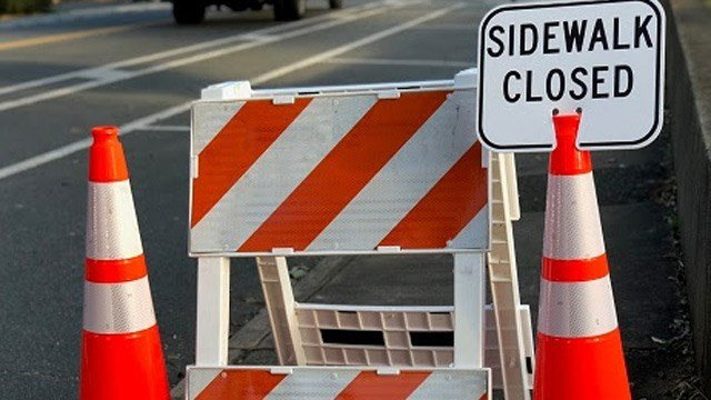 A sidewalk along the Route 250 bypass is closed for bridge repair.