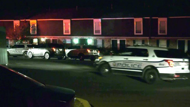 Police on the scene of a shooting at Barracks West Apartments