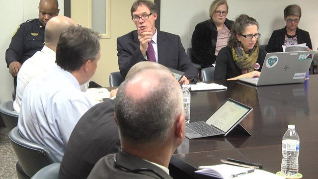 Officials met on Tuesday to discuss the new pay scale system.