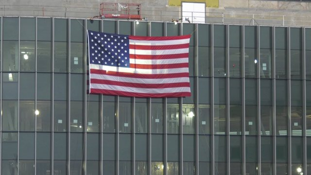 Flag hung outside new construction at the UVA Medical Center