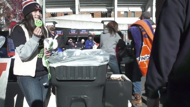 UVA students encouraging Cavalier fans to recycle