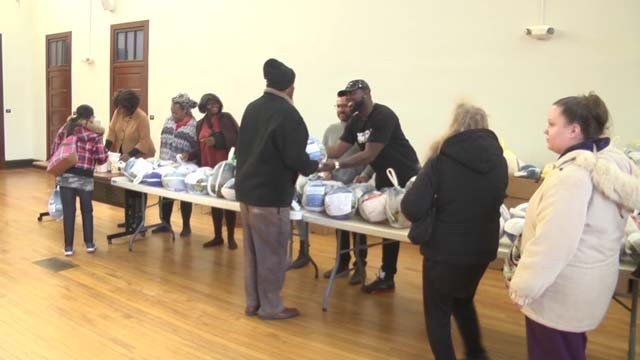 Volunteers handed out to turkeys to families in need