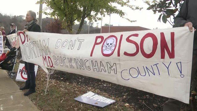 Protesters gathered in front of Dominion Energy on Monday.