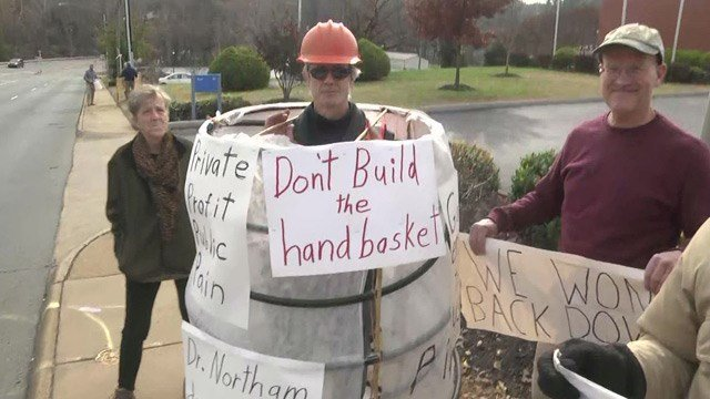 The protesters are speaking against a decision by Governor Northam.