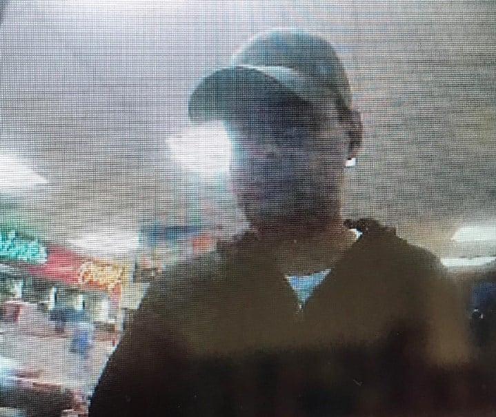 Surveillance photo of credit card fraud suspect