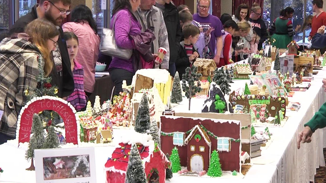 Community members voting on the best gingerbread house.