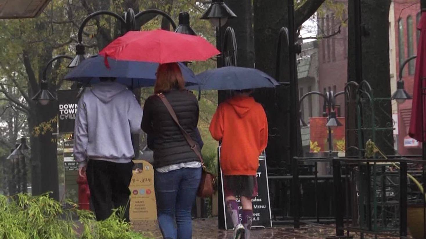 Downtown Mall customers braving the dreary weather.