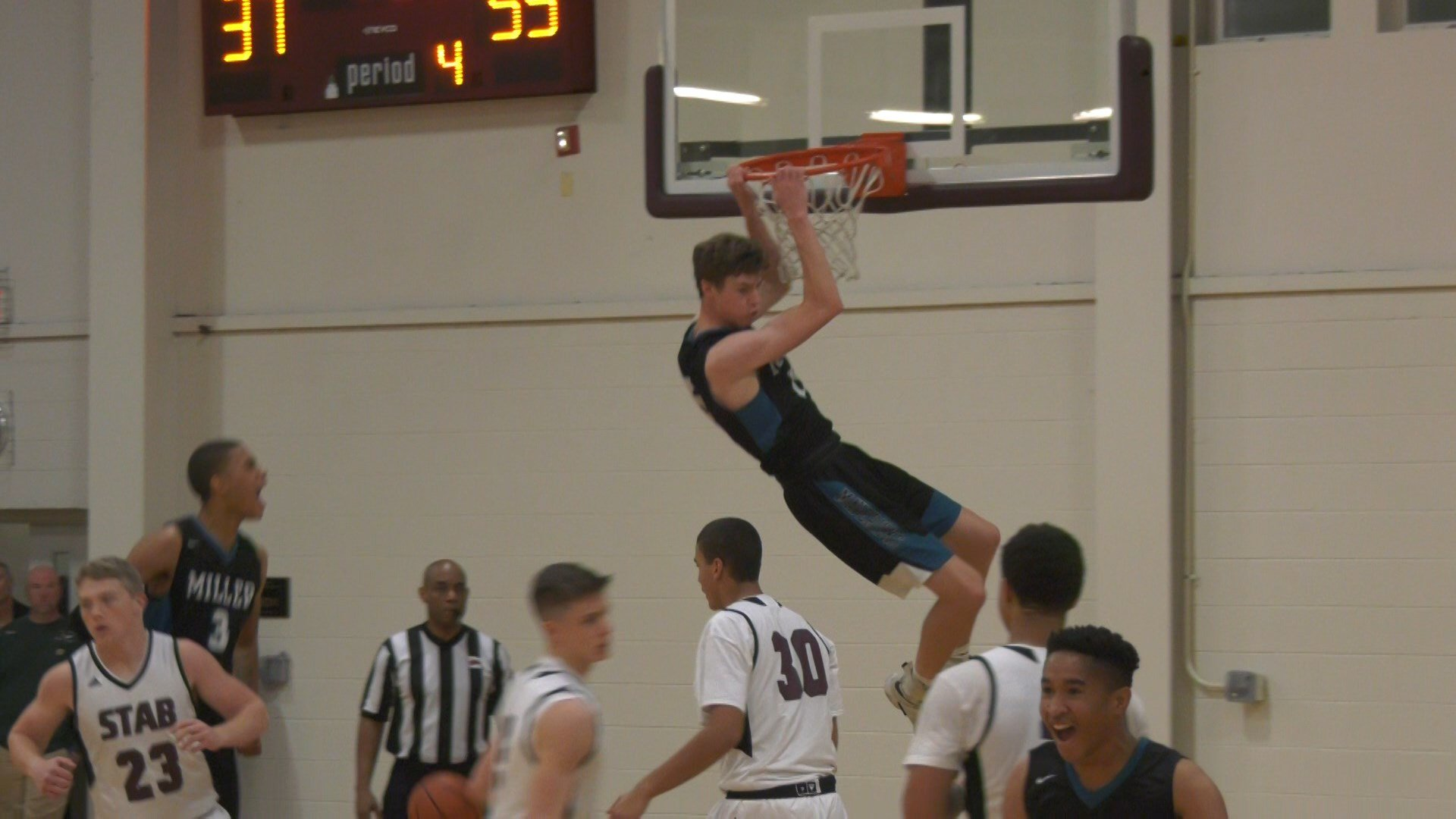 Miller's Garrett Payne with the slam dunk