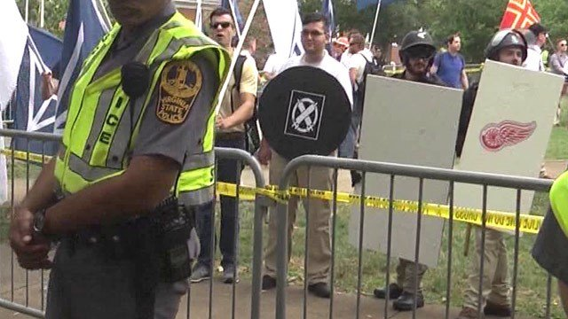 James A. Fields, Jr. (center) holding a shield while participating in the Unite the Right rally (FILE IMAGE)