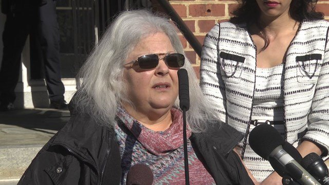 Susan Bro speaking to the media outside Charlottesville Circuit Court