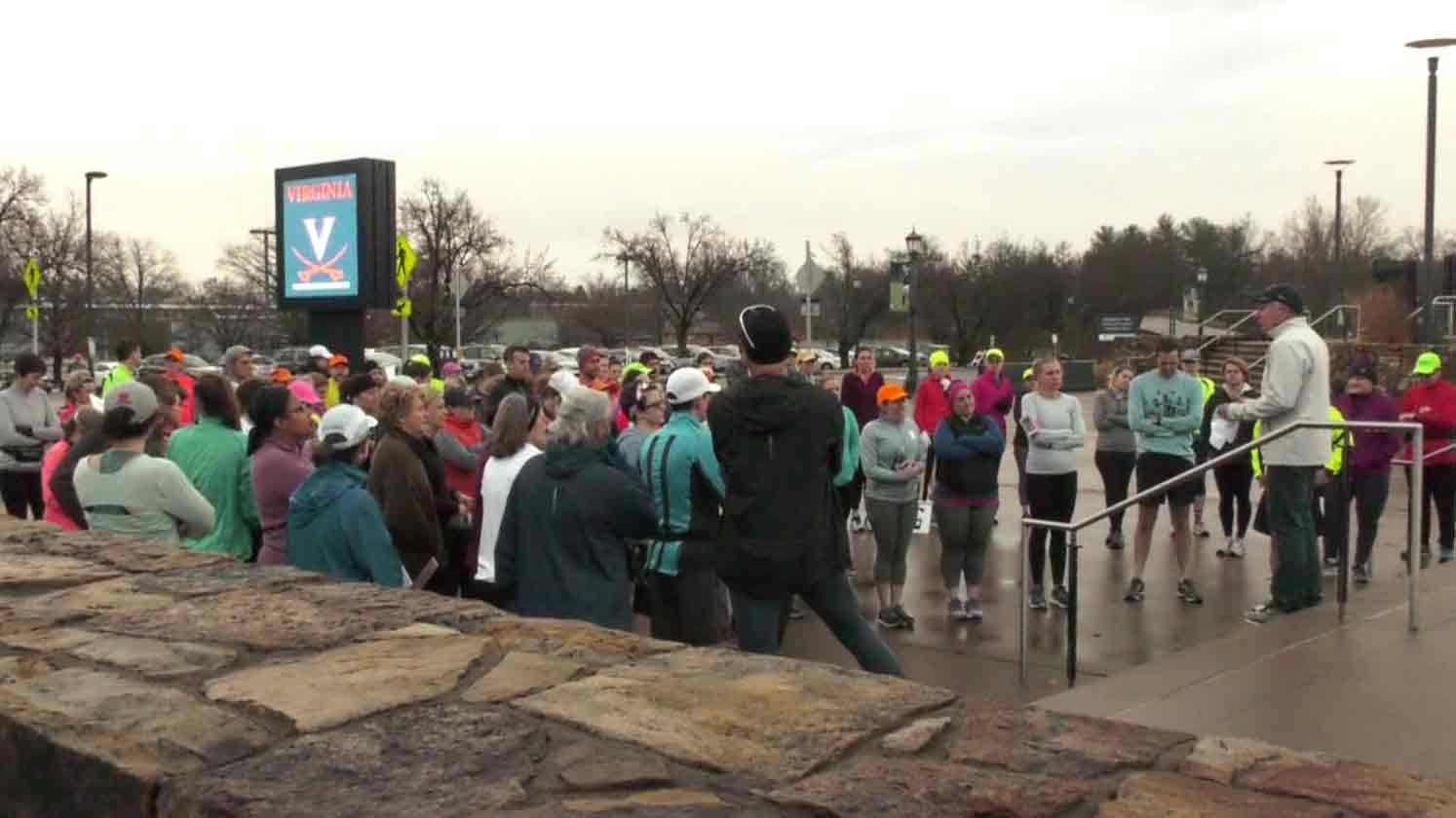 Runners getting instructions in regards to the days training.