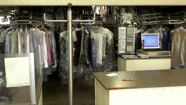 The front desk of Brown's Cleaners where customers can pick-up their items.