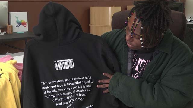 Pettiford prints T-shirts with inspirational slogans on them