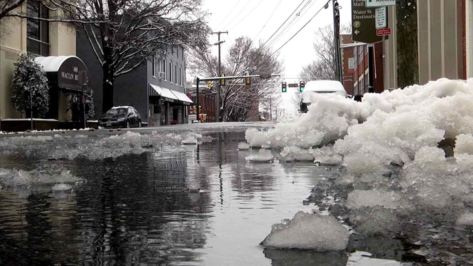 Slush and snow piled on the side of the road in Downtown Charlottesville.