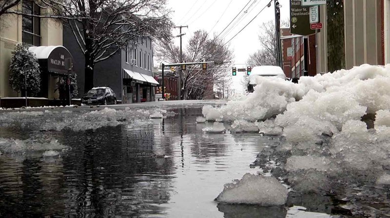 Sleet and snow piled next to the road in downtown Charlottesville.