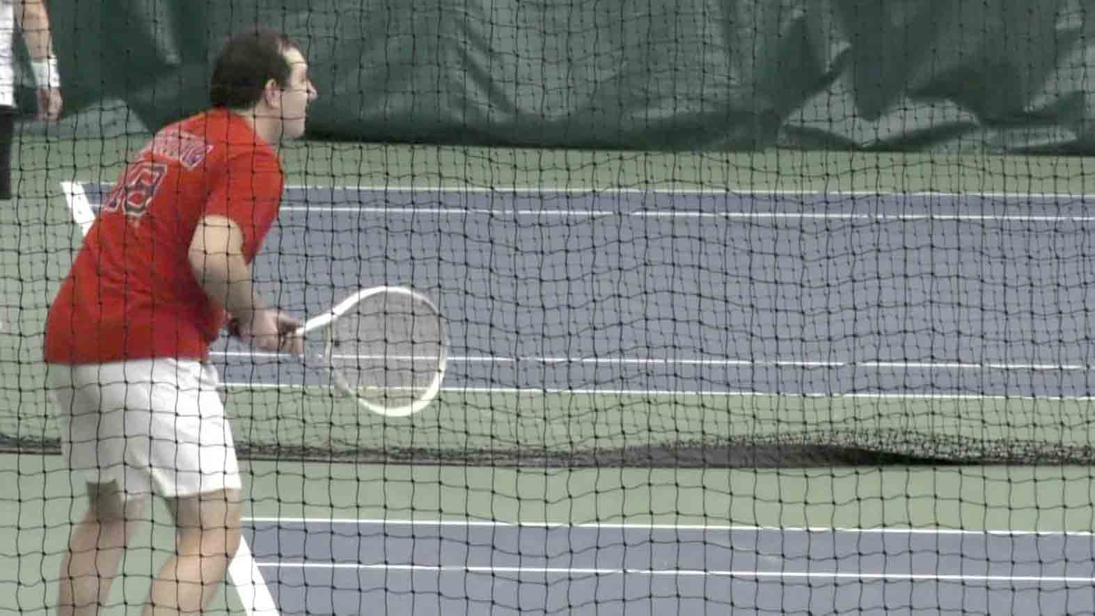 One of the athletes in the Virginia Experience Special Olympics Tennis Tournament during his match.