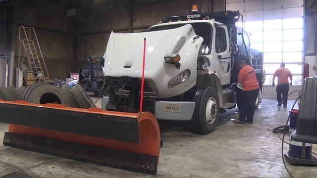 Crews working on a plow truck