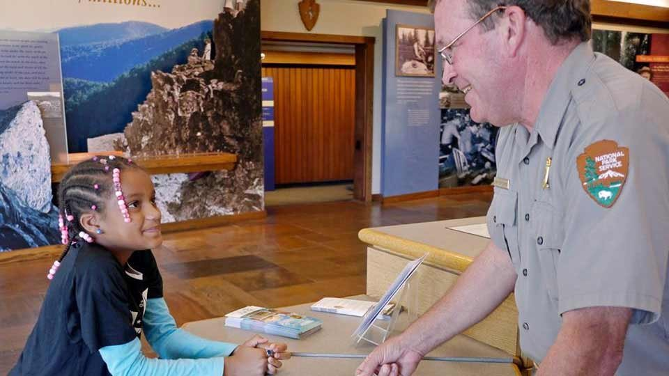 A National Park Service employee with one of the younger guests.