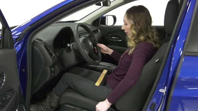 Becky Mueller demonstrating a safe distance from the wheel