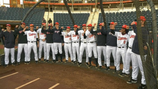 The thirteen UVa freshman sang 'The Good Old Song' before the start of practice on Friday