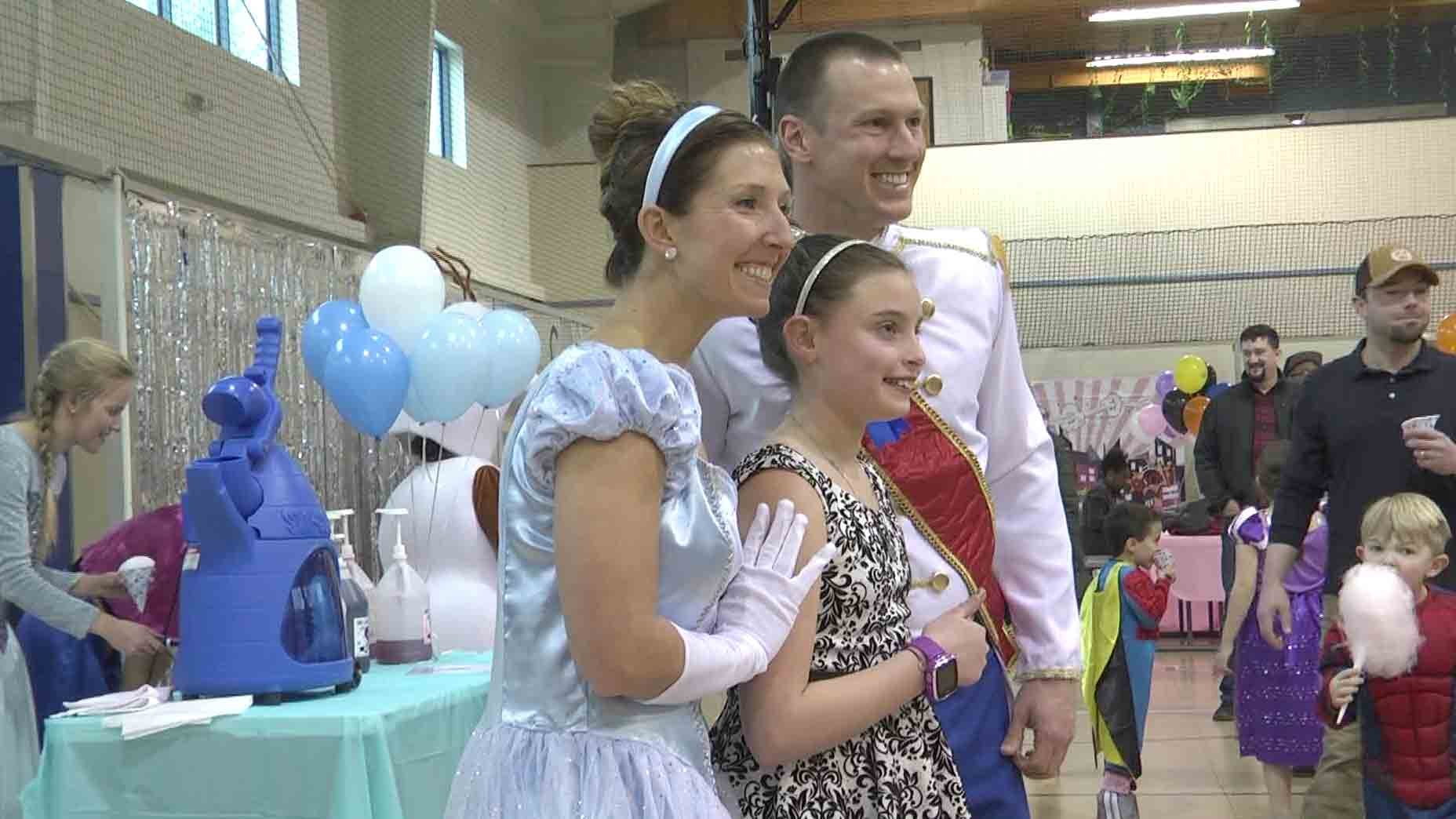 Cinderella and Prince Charming took photos with children at the Super Magical Ball.