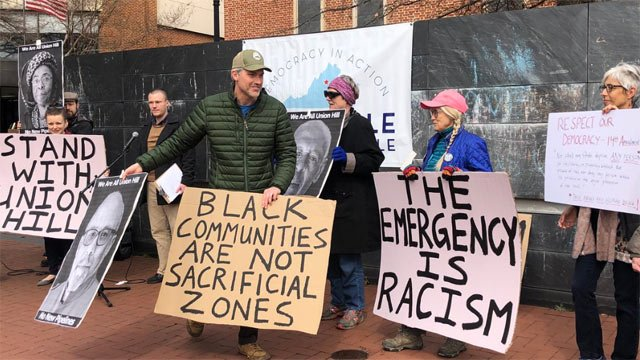 Indivisible Charlottesville is protesting Trump's emergency declaration.