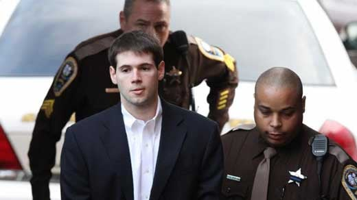 File Image: George Huguely being escorted into court
